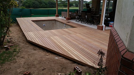 Angular pool deck off patio