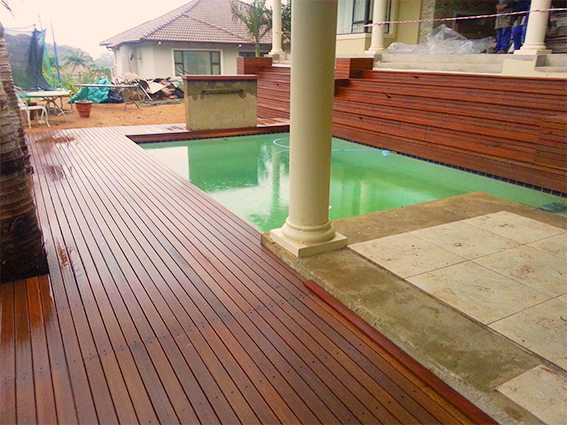 Wooden pool deck with stairs